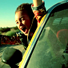 were_duck: Young girl leaning out of car window, grinning and arms flung wide (Killjoy kid whee)