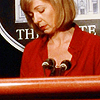 chaila: CJ Cregg at the press podium, looking down and kind of sad. (tww - cj)