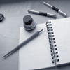 actionreaction: photo of a blank journal with fountain pen and ink (journal)