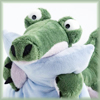 commodorified: very worried stuffed crocodile clutching a pillow (not coping)