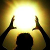 actionreaction: photo of a silhouette of a woman with hands cuppoed over her head, around the sunlight ([shadowbinder] lucent; sun casting)