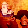 petra: A white woman and a black man in unitards, reaching for the sky (Britta & Troy - Gotta dance)