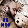 thingswithwings: a big hairy bear all curled up with a teddy bear; text: KB MOD (KB - teddy bear)