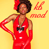 eruthros: kink bingo mod icon: a person wearing a latex dress and a flower in their hair (kb mod: latex)