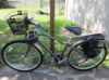onlysmallwings: A Dutch-style grey bike with panniers and a metal front basket (Biking)