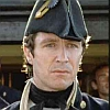 shakenandlimp: Man in UK royal naval uniform circa 1880 looks into camera: has piercing blue eyes (Serious)