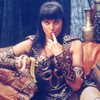 theoriesontales: Xena eating a banana, looking either innocent or seductive (whups, Xena)