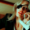 meloukhia: Elle Driver from 'Kill Bill.' She is a blonde woman wearing an eyepatch and talking on a cell phone. (Elle Driver)