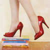 snarky: (red shoes on books)
