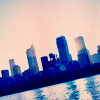 sunspot: skyline of city by water, tilted to one side (tilted skyline)