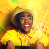 lowellboyslash: Troy Barnes in a yellow cowboy outfit popping out of a bin with a smile on his lovely face (Troy)