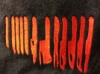 josephine_marrs: A series of red knives against a black background (pic#6492387)
