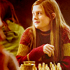 meloukhia: Ginny from 'Harry Potter' with a chessboard in front of her, looking to the left.  (Ginny plays chess)