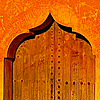juniperphoenix: Orange door with pointed archway (Door 3)