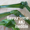 "vi: Pandan leaves in the background. Text says, ""Flavoursome AND inedible"" (pandan leaves)"