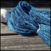 lizcommotion: blue handspun yarn on a weatherbeaten bench with a seashell next to it (yarn blue handspun)