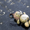 recessional: a worn out stuffed bear keyring on the ground (writing; goes away in the end)