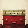 turlough: three vintage suitcases piled atop each other ((other) there and back again)