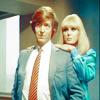 rydra_wong: Silver is smug; Sapphire has her hands on his shoulders. (sapphire and steel -- smug)