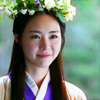 ends_with_ice: Seo-hwa smiling and wearing flower crown (she walks beautiful)