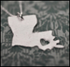 pinesandmaples: A silver necklace in the shape of a Louisiana with a heart cutout. (theme: split apart)