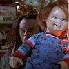 terajk: Charles Lee Ray hiding behind a Good Guy doll and holding a gun. (the other me needs batteries)