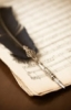 era_penn: Elegant feather-quill pen on top of half-filled parchment paper. (pic#6564486)