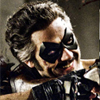 halialkers: Man with grey temples in hair clutching gun, masked, smiling (Edward)