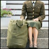 loveandwar: A woman in military uniform, sitting quietly next to her go-bag (Standing by)
