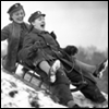 loveandwar: A black-and-white photo of two women in World War II uniforms, careening down a hill on a toboggan (YOU CAN'T STOP ME)