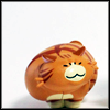 lizbee: A picture of a Japanese toy in the shape of a fat, orange, happy cat (Random: Fat nomcat)