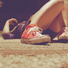 sarken: girl in red chucks lying on her back with bent knees ([misc])