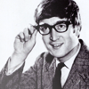 sandoz_iscariot: John Lennon in a suit and glasses, striking a nerdy pose. (Beatles: NEEEEEERD!)