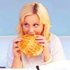 iulia: Leslie Knope in a hospital bed, eating a waffle (Default)