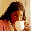 gavagai: Tara Thornton drinking from a large mug of coffee (tara's morning face)