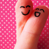 quiric: two fingers with happy faces drawn on them on pink polka-dot background (happy fingers)