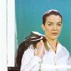 muccamukk: Susan in a white shirt with her uniform jacket slung over her shoulder, looking tired. (B5: Done with the day)