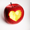 lienne: An apple with a heart-shape cut into it. (emotion: affectionate)
