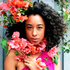 timeasmymeasure: corrine bailey ray with flowers in her hair (corrine: flowers in my hair)