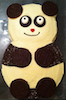 chris: A birthday cake in the shape of a slightly cartoon-like panda (panda!cake)