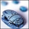 treefrog: a blue egyptian scarab (Scarab)