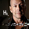 "healingmirth: Brude Willis, looking in a doorway with a chain across at;  ""hi"" (hi)"