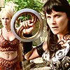 halialkers: Xena holding chakram, Gabrielle on right, brunette with circular blade black armor, blonde red leather (Metari H'vat Ta'eris)