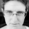 adularia: Photo of me, in black and white, with my glasses tilted. (Default)