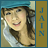 "jain: Chae Yeon leaning forward and smiling. Text: ""Jain"" (ronon)"