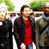 subluxate: Parker in black, Eliot in a red shirt and black leather jacket, and Hardison in a grey long-sleeved shirt and blue scarf (Leverage: OT3: The Rundown Job)