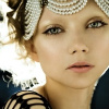 signifier: a young, fragile looking woman with a pearl headdress (Qadeen: Alora (Gold-scales's Rider))