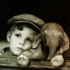 hokuton_punch: A photograph of a boy and a baby elephant. (iconomicon boy elephant)