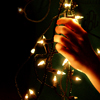 existence: stock icon of hand with christmas lights (fiat lux)