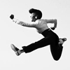 instantramen: black woman with a serious pompadour in exaggerated running pose mid-air (onward!)